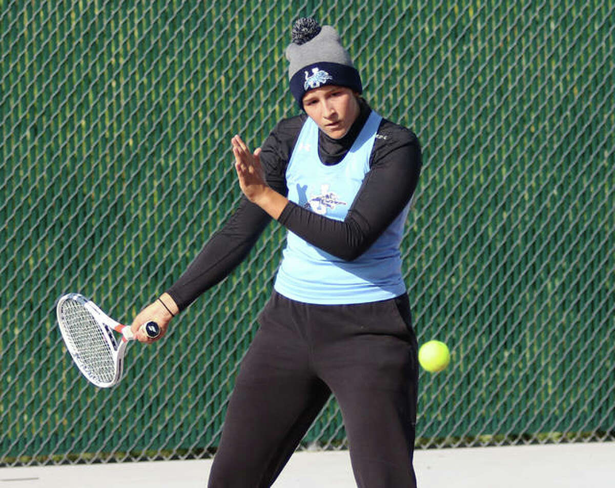 Jersey senior Michelle Maag, shown hitting a forehand return on a chilly Sept. 19 morning at the Robert Logan Invite at Alton High in Godfrey, closed her prep career with the Panthers by winning a Class 1A sectional doubles title Saturday at Quincy.