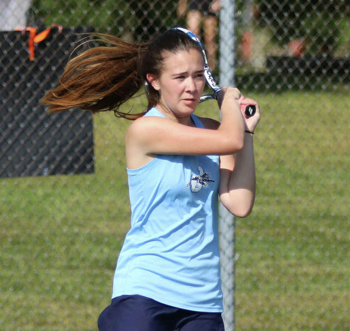 Jersey junior Lily Ingram, watches her backhand return during a Sept. 25 dual at Edwardsville, teamed with Michelle Maag to win the program's first sectional title on Saturday at the Quincy Notre Dame Class 1A Sectional.