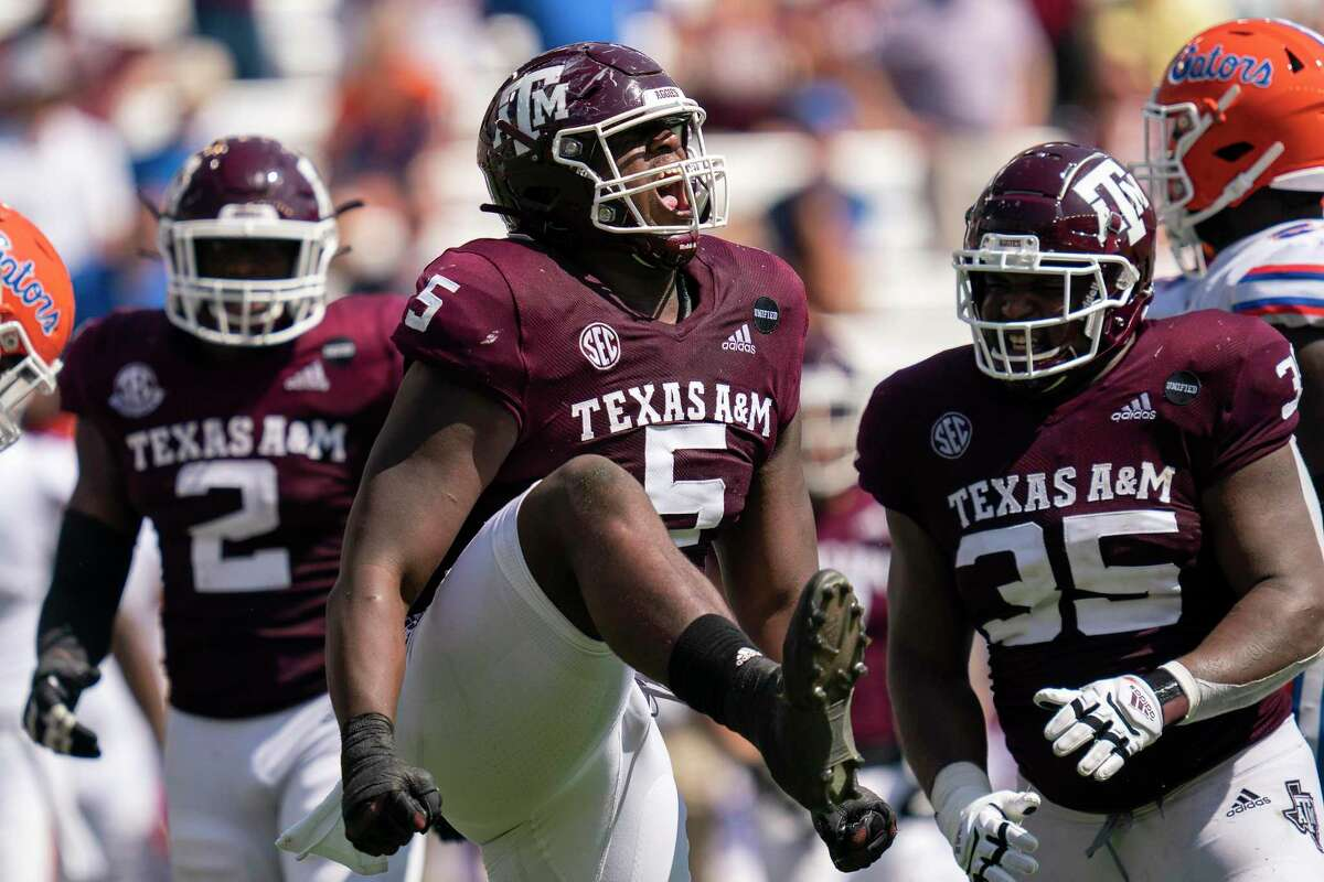 Texas A&M defensive lineman Bobby Brown III (5) reacts after sacking Florida quarterback Kyle Trask (11) during the second half of an NCAA college football game, Saturday, Oct. 10, 2020. in College Station, Texas. (AP Photo/Sam Craft)