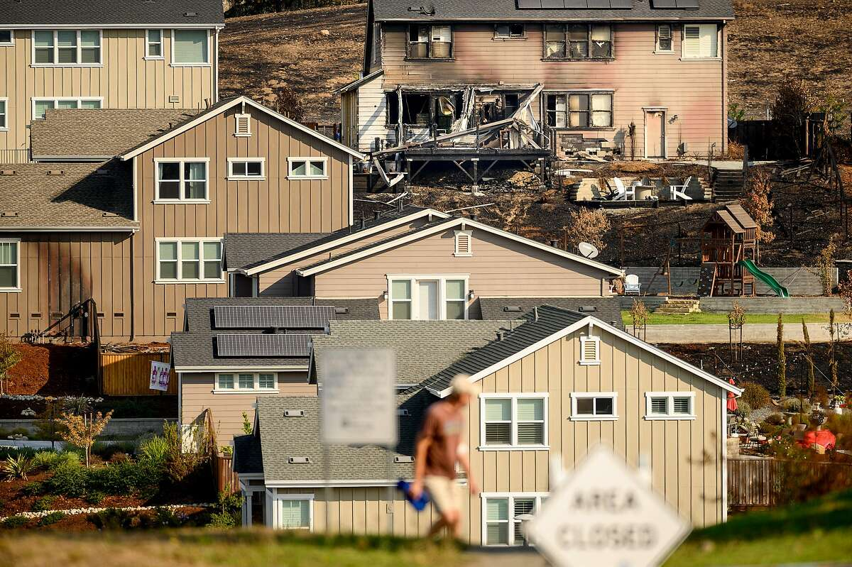 A Sunhawk Dr. home scorched by the Glass Fire stands among unburned residences on Tuesday, Oct. 6, 2020, in Santa Rosa, Calif.