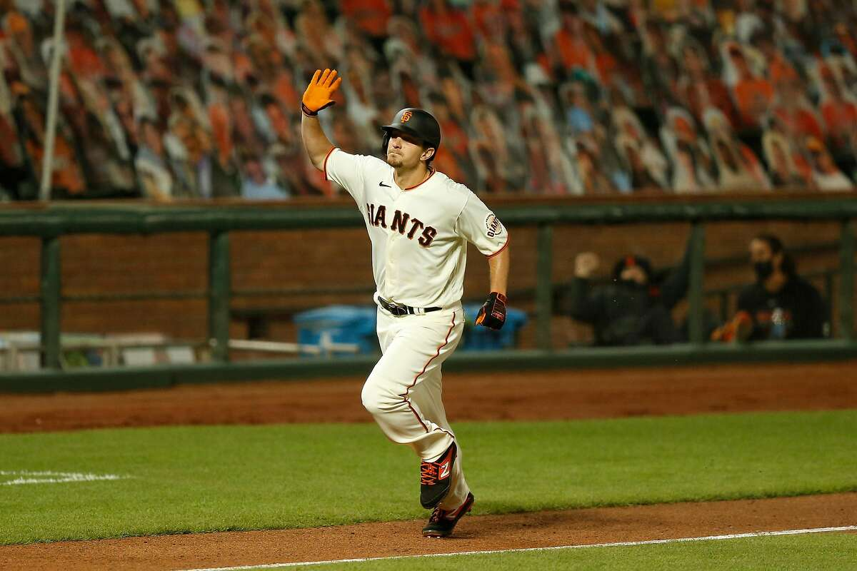SAN FRANCISCO, CALIFORNIA - SEPTEMBER 21: Alex Dickerson #12 of the San Francisco Giants reacts after hitting a solo home run in the bottom of the seventh inning against the Colorado Rockies at Oracle Park on September 21, 2020 in San Francisco, California. (Photo by Lachlan Cunningham/Getty Images)