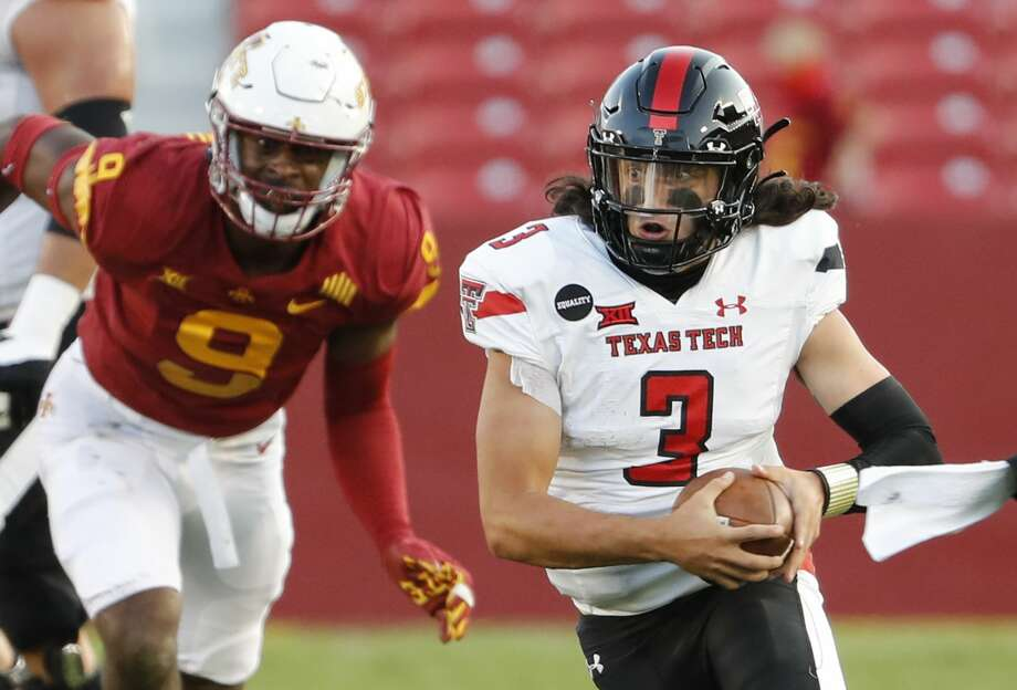 AMES, IA - OCTOBER 10: Quarterback Henry Colombi #3 of the Texas Tech Red Raiders scrambles for yards as defensive end Will McDonald IV #9 of the Iowa State Cyclones puts pressure on in the second half of the play at Jack Trice Stadium on October 10, 2020 in Ames, Iowa. The Iowa State Cyclones won 31-15 over the Texas Tech Red Raiders. Photo: David K Purdy/Getty Images / 2020 David K Purdy