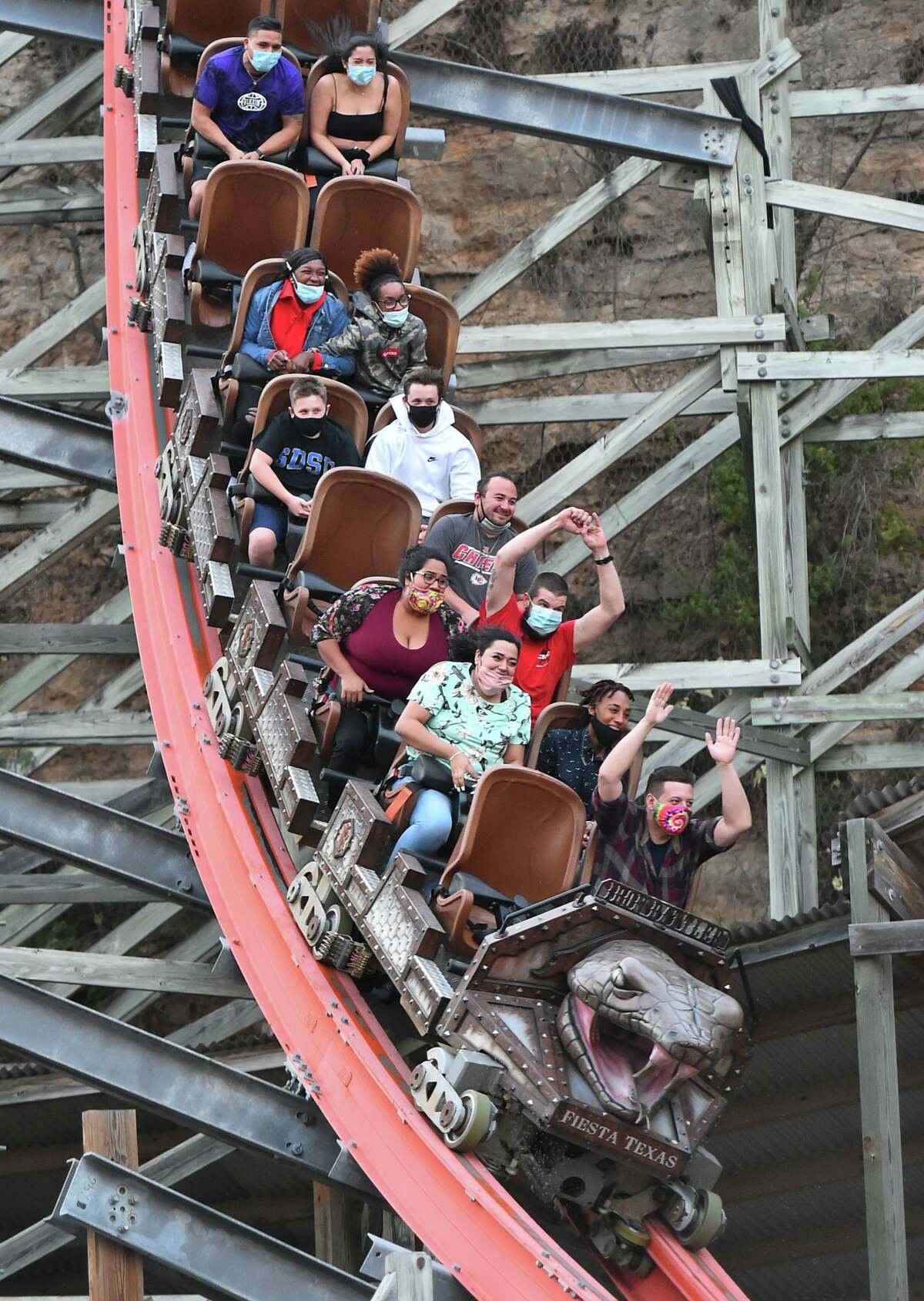 Visitors ride the Iron Rattler during Halloween activities at Six Flags Fiesta Texas. The haunted houses have moved outdoors with social distancing and mask protocals in place.