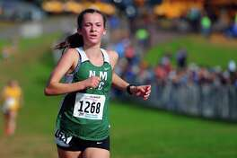 New Milford's Claire Daniels crosses the finish line for second place during Class L cross country championship action in Manchester, Conn., on Saturday Oct. 26, 2019.