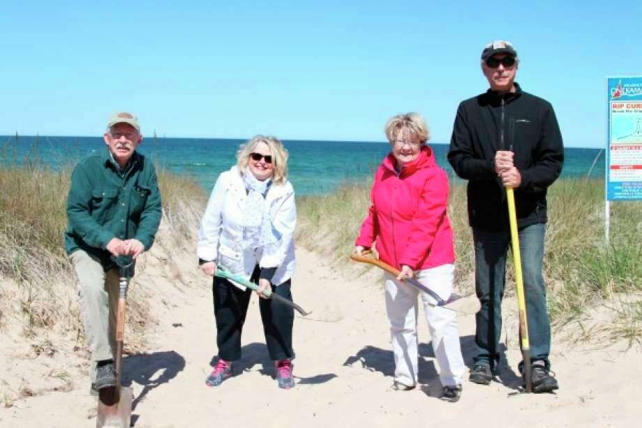 Pictured (from left to right) are Phil Joseph (Explore the Shores); Diane Bess (Portage Lake Association); Mary Reed (Portage Lake Watershed Council); and Dave Meister (Onekama Township supervisor), all on hand for the ceremonial groundbreaking for the Langland Park beach recreation project in 2016.The park's development received a Michigan DNR Trust Fund grantin 2015 for $261,000. (File photo)
