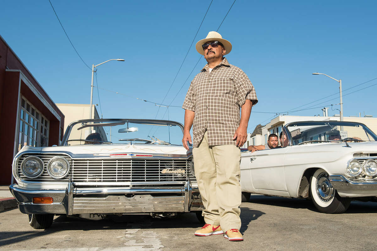 Roberto Hernandez, founder of the San Francisco Lowrider Council, poses in front of his Chevy Impala on Oct. 17. for the sixth annual Cold Frisco Nights in the Mission.