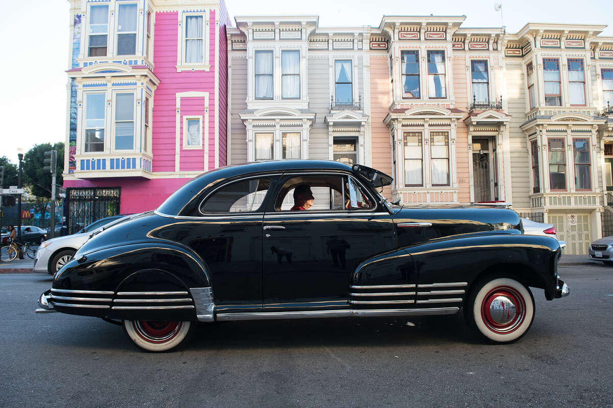 Dan sits in an old black Chevy. The San Francisco Lowrider Council gathered Saturday, Oct. 17, 2020, for their 6th annual Cold Frisco Nights in the Mission.