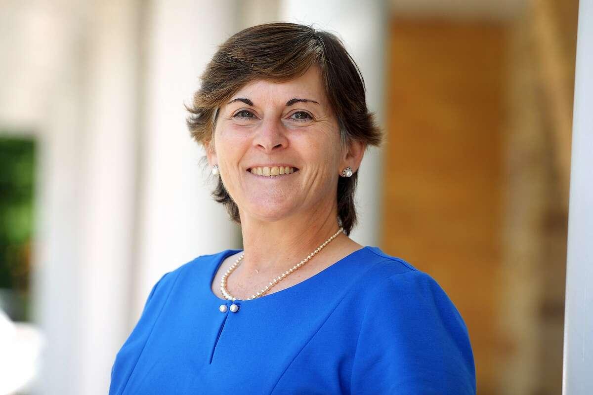 Beth Smith, Interim Superintendent of Schools, poses outside Sunnyside Elementary School, in Shelton, Conn. Sept. 30, 2020.