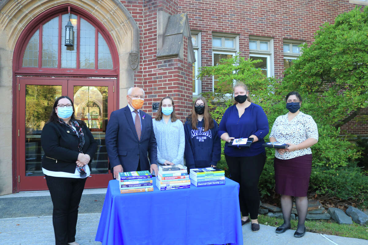 Paul D. Tonko visited Maria College yesterday to meet with students and deliver 22 items including medical and health care books, valued at approximately $1,013, which he has collected for donation through the Library of Congress Surplus Books Program.