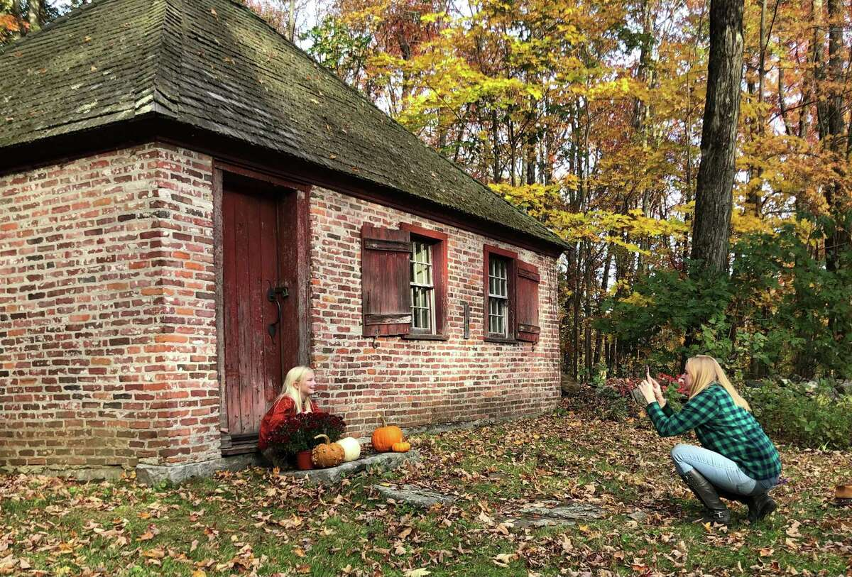 A recent grant will soon support the restoration of a new roof and windows of Brick School. Katie Chernak visited the schoolhouse Oct. 18 to use it as a backdrop for photos of her daughters, Molly, 9 and Alyssa, 2, not shown.