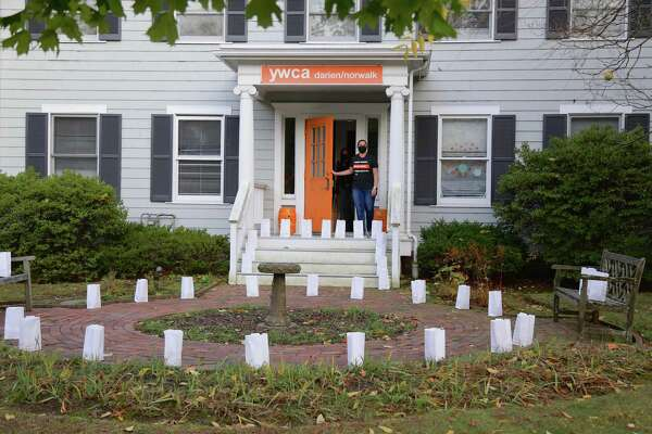 Luminaries in place to light awareness on domestic violence and increase education about how people can find help, outside the YWCA Darien/Norwalk headquarters.