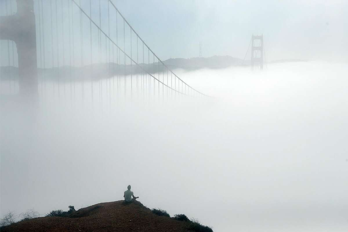 Ivan Gushchin meditates at Marin Headlands on Monday. Fog is expected to disappear later this week, lowering humidity and adding to the region's fire danger.