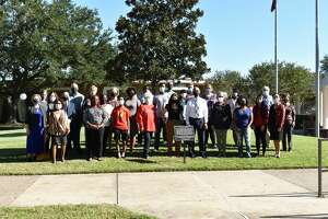 """Current and former """"Dreamers"""" with IHAD board members, IHAD Student Affairs Director Margueritte Humphrey and Lamar University representatives."""