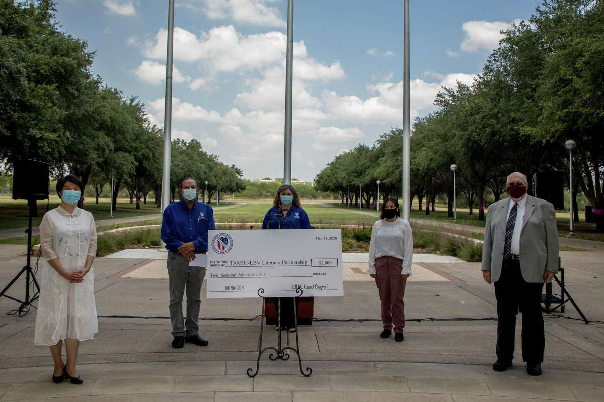 On the right,, TAMIU-LBV Partnership executive director Dr. Xuesong Wang, LULAC No. 7 vice president José González, LULAC Education Committee chair Nora Montemayor, LULAC member Virginia López and TAMIU President Dr. Pablo Arenaz were on hand for the donation. Left, Arenaz thanks LULAC Council No. 7.