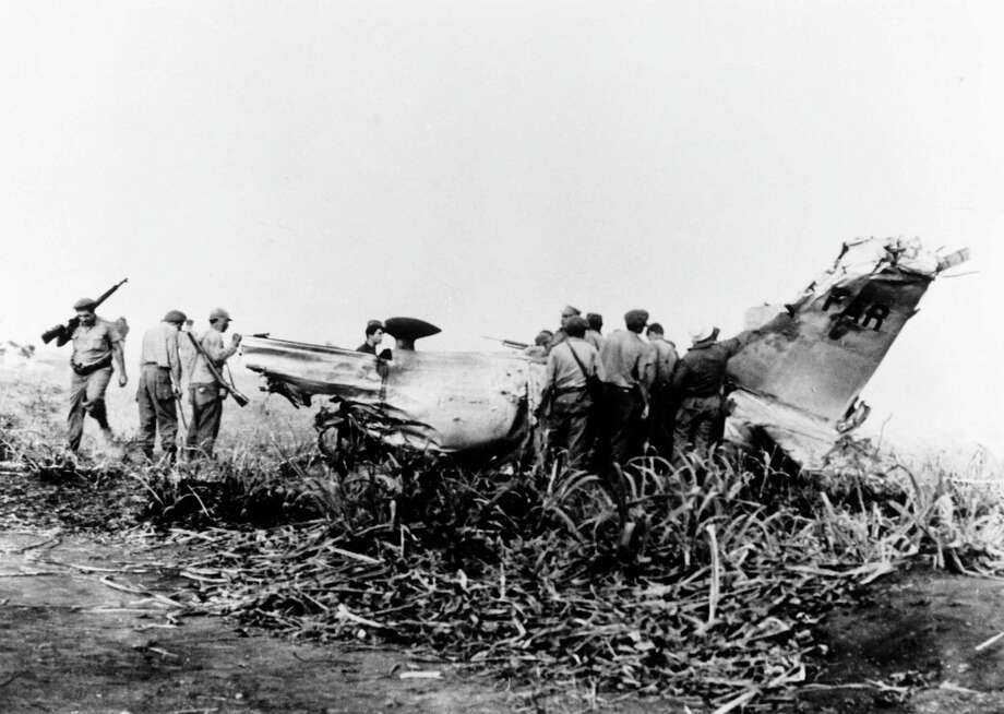 An anti-Castro plane shot down during the failed Bay of Pigs invasion of Cuba in 1961. Bissell was instrumental in planning the operation, and its failure resulted in the end of his career at the CIA. Photo: Gamma-Keystone Via Getty Images / Gamma-Keystone Via Getty Images / 1961 Keystone-France