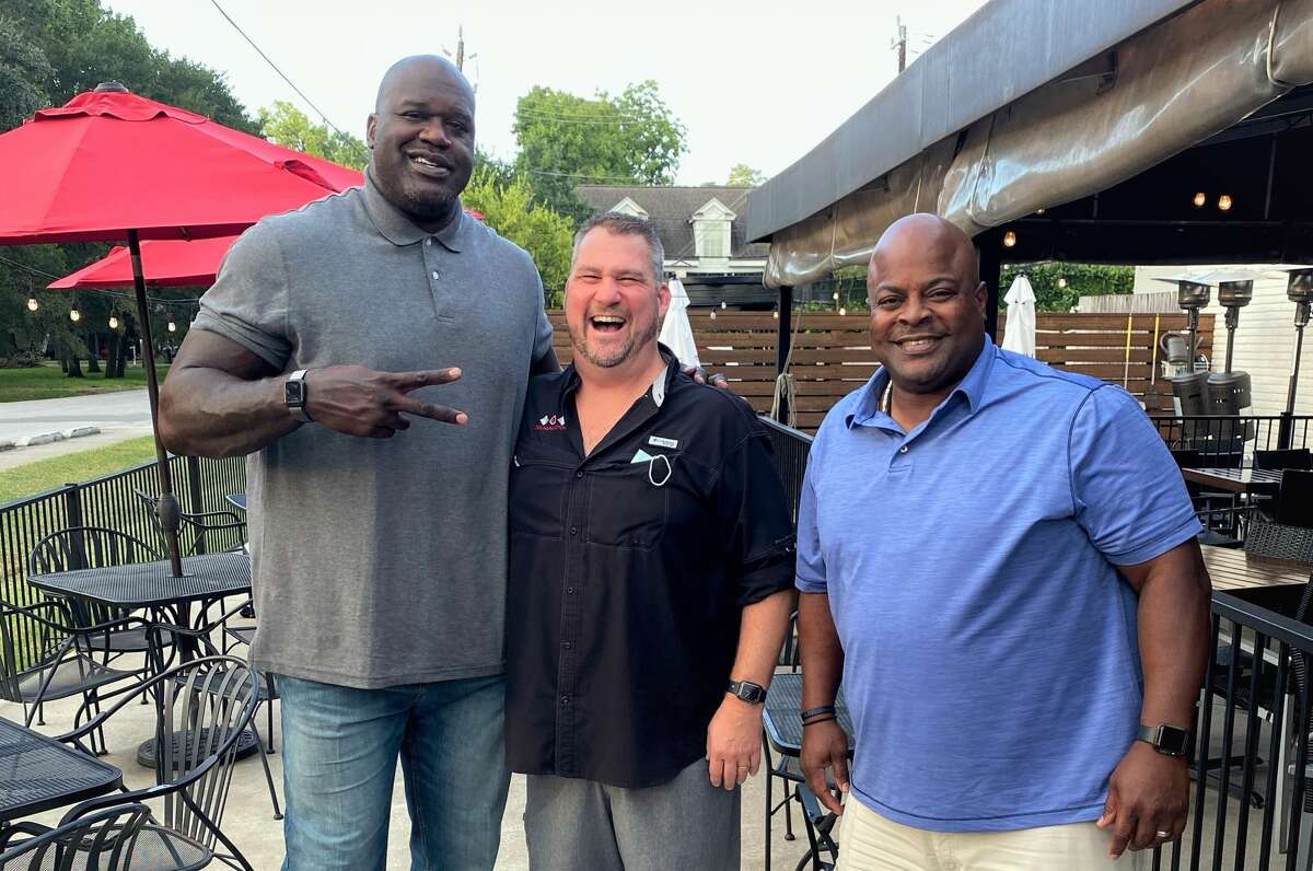 Shaquille O'Neal, Gr8 Plate Hospitality owner Paul Miller, and Houston Police Officer Kenneth Miles at The Union Kitchen Memorial on Oct. 19, 2020.