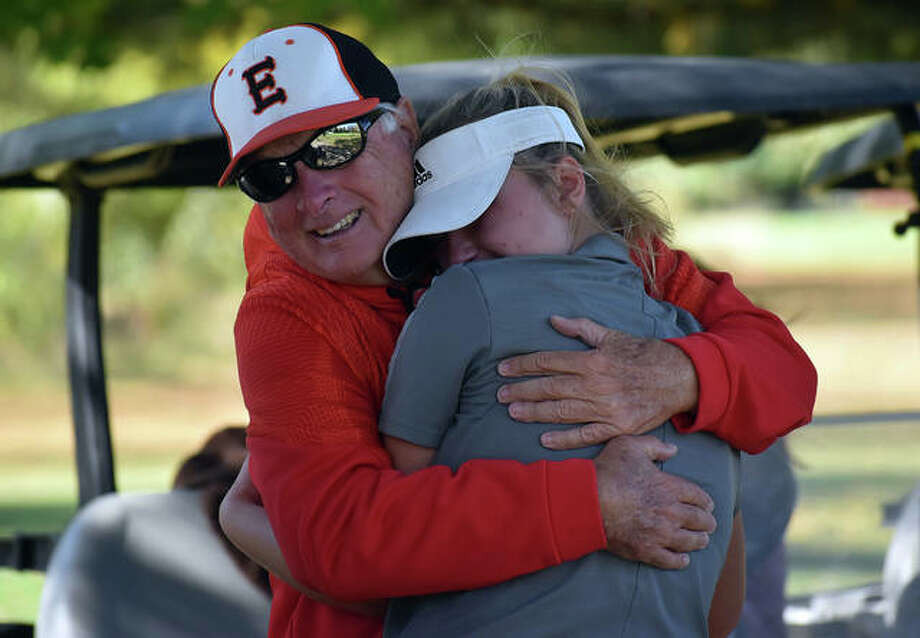 Edwardsville senior Riley Burns hugs her grandpa, Ken Burns, after completing her round at the Class 2A Champaign Centennial Sectional on Oct. 13 in Savoy.