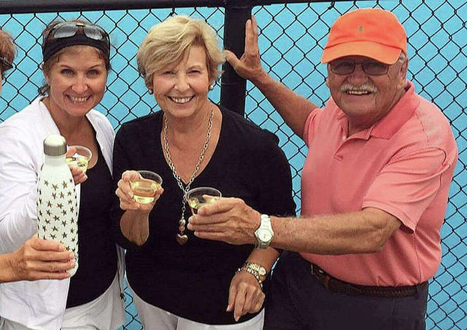 Edwardsville graduate Lori (Zupanci) Saguto celebrates with her parents, Gloria and Jim, after winning her singles match at the USTA Illinois State Championships in Champaign at the University of Illinois in 2017. Saguto's team also won and advanced to the Midwest Championships in Indianapolis. Photo: For The Intelligencer