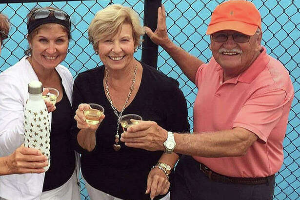 Edwardsville graduate Lori (Zupanci) Saguto celebrates with her parents, Gloria and Jim, after winning her singles match at the USTA Illinois State Championships in Champaign at the University of Illinois in 2017. Saguto's team also won and advanced to the Midwest Championships in Indianapolis.