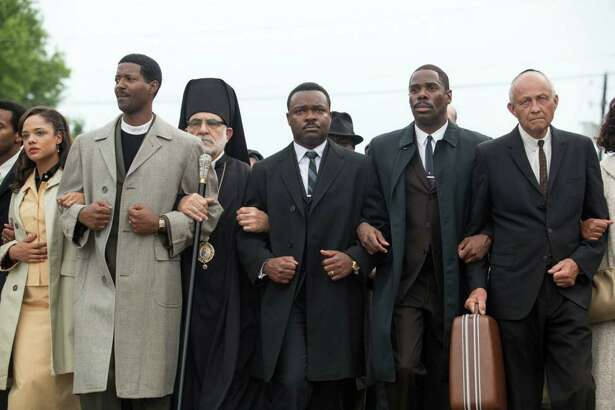 "Rev. Dr. Martin Luther King Jr., portrayed by David Oyelowo, center, leads a civil-rights march in the new movie, ""Selma."" The film will be screened at the Ridgefield Playhouse on Oct. 28."
