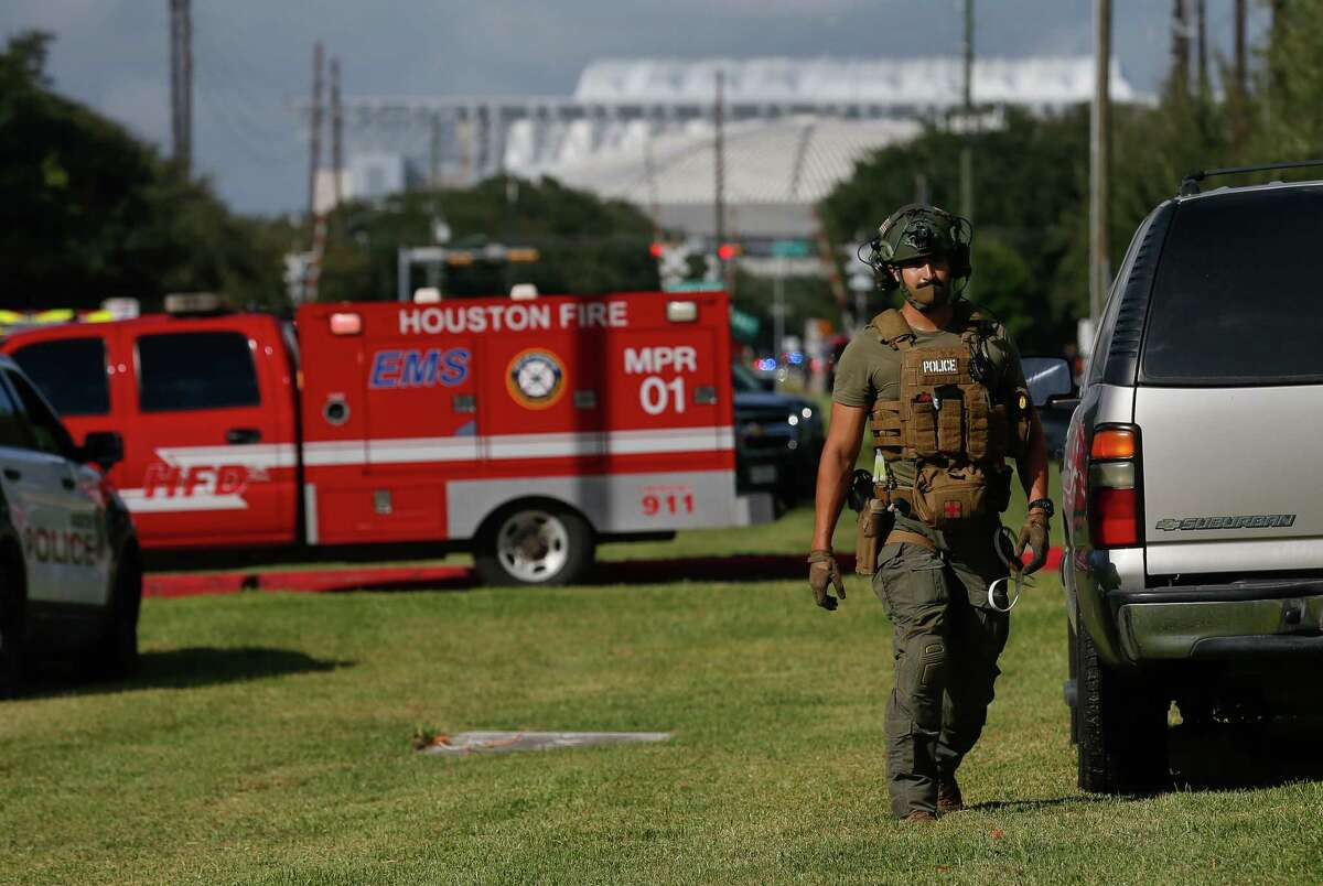 Law enforcement officials at the scene of an officer-involvedshooting at an apartment complex near El Rio and Holly Hall streets on Tuesday, Oct. 20, 2020, in Houston.