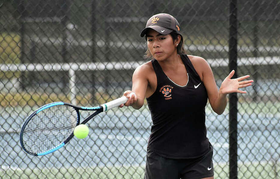 Edwardsville senior Chloe Trimpe hits a return shot during her singles match in the Southwestern Conference Tournament in Alton.
