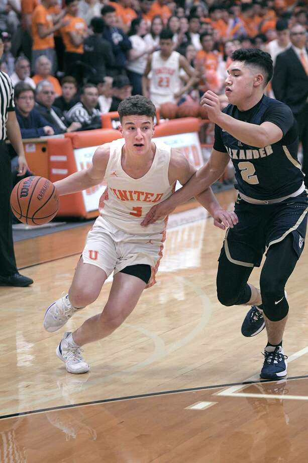 Frankie Viro controls the ball for the United Longhorns as Bobby Torres defends for the Alexander Bulldogs Friday, February 7, 2020 at the United Gym. Photo: Cuate Santos / Laredo Morning Times / Laredo Morning Times