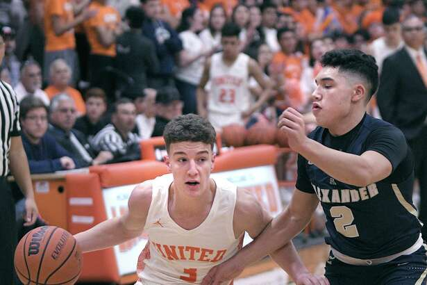 Frankie Viro controls the ball for the United Longhorns as Bobby Torres defends for the Alexander Bulldogs Friday, February 7, 2020 at the United Gym.