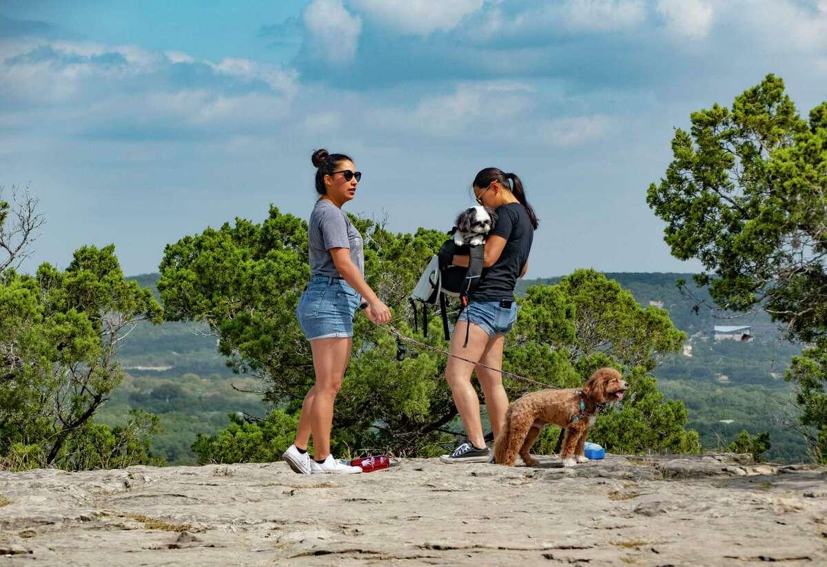 Ericka Contreras and Jacqueline Tran walk their dogs atop Old Baldy.