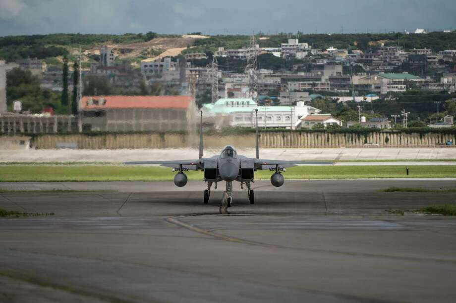 In this June 29, 2017, photo made available by the U.S. Air Force, an F-15 fighter plane taxis back to the hangar at Kadena Air Base, Japan. The Defense Department has been figuring out how to provide help and justice when the children of service members sexually assault each other on military bases since Congress required reforms in 2018. Those reforms are starting to rollout, but as one current case at Kadena shows, that rollout has been uneven. (Airman 1st Class Greg Erwin/U.S. Air Force via AP) Photo: Greg Erwin / Associated Press / U.S. Air Force