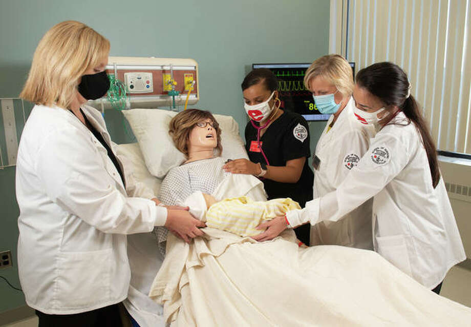 The Southern Illinois University Edwardsville School of Nursing students and faculty engage in simulation learning in the school's new clinical simulation lab.