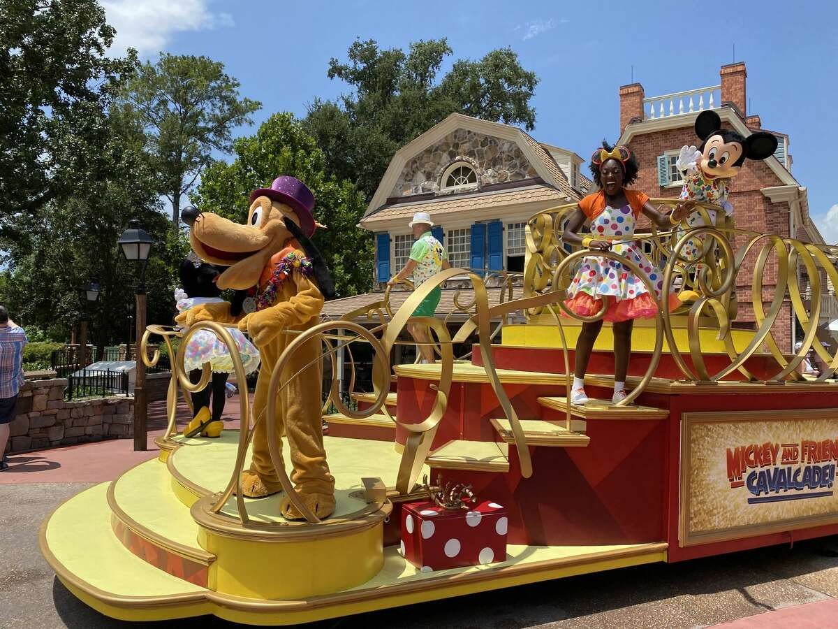 Unannounced character cavalcades have replaced parades to discourage crowds gathering at Walt Disney World in Orlando, Fla.