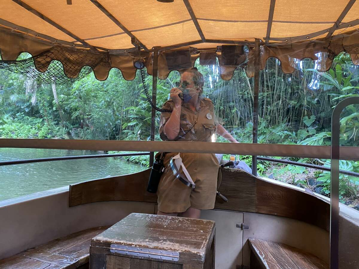 Rides like Jungle Cruise have had plastic dividers installed to protect guests and cast members at Walt Disney World in Orlando, Fla.