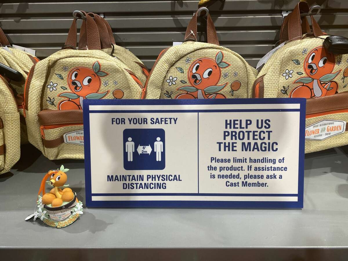 Guests are discouraged from handling merchandise to reduce contamination risks at Walt Disney World in Orlando, Fla.