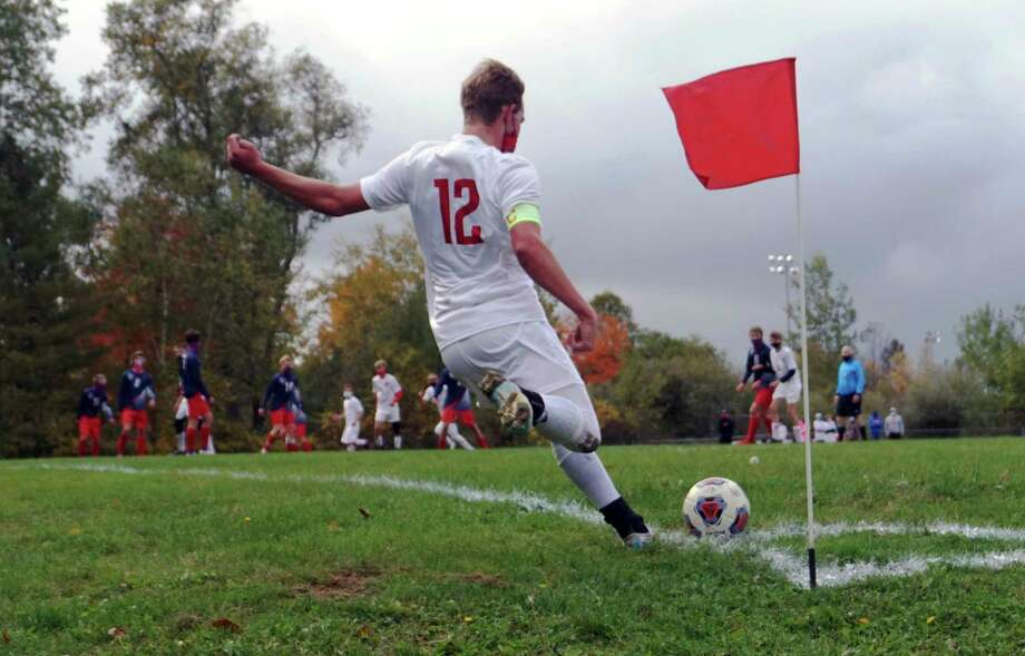 Reed City's Parker Benedict strikes the ball on a corner kick during RC's game at Big Rapids on Oct. 1. (Pioneer file photo/Joe Judd)