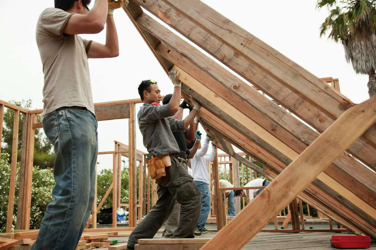 Stock images of residential construction and carpenters.