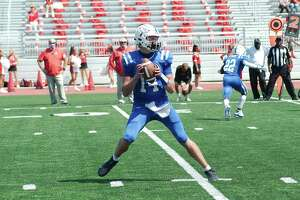 Clear Springs quarterback Luke Sampson (14) is finding his comfort zone as the Chargers' signal-caller.