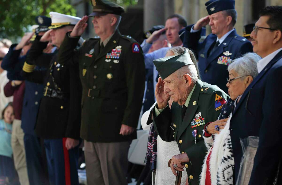 90-year-old Tomas Fajardo (third from right), U.S. Army veteran of World War II, Korea and Vietnam, salutes along with the commanders from their respective branches of the military during the retiring of colors at the U.S. Veterans Day Parade Association's wreath presentation ceremony at the Alamo on Saturday, Nov. 9, 2019. (Kin Man Hui/San Antonio Express-News)