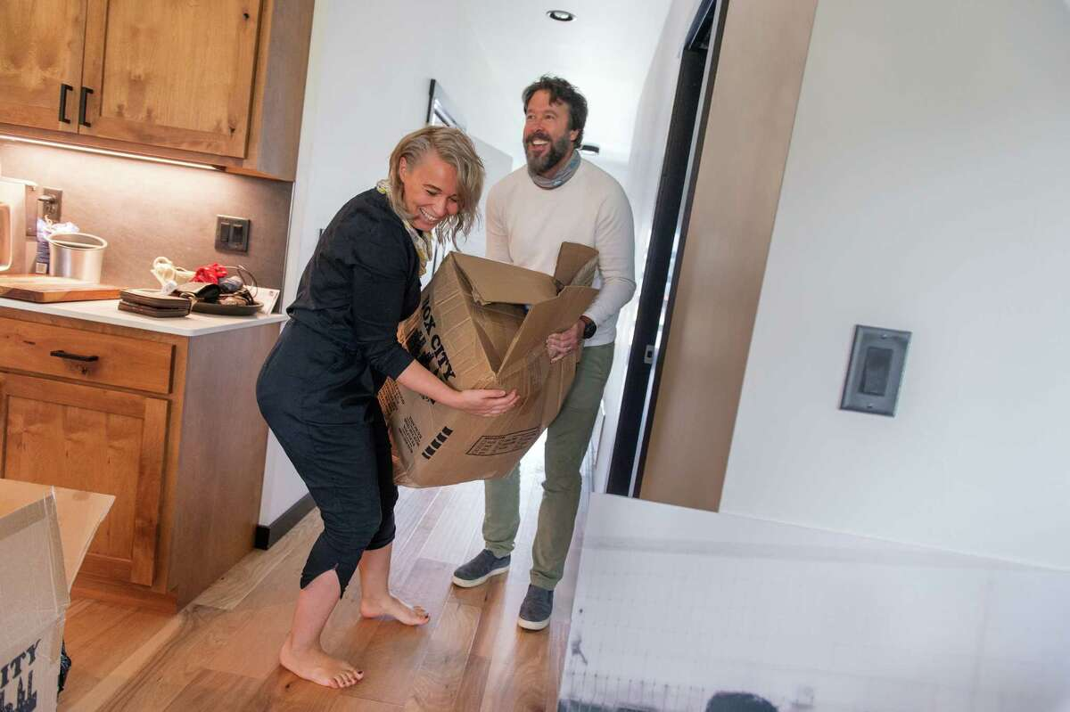 Robert and Valentina Carder move into their new home in Bozeman, Mont., in August. They fled Los Angeles.