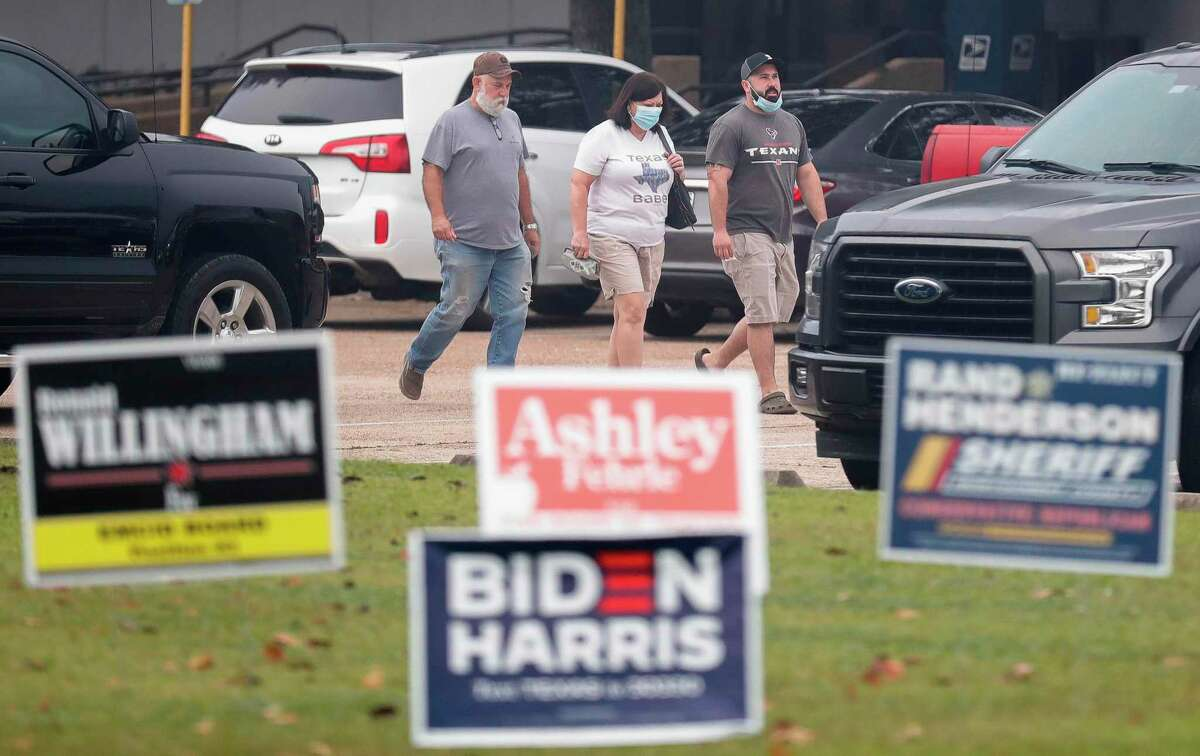 Residents head back to their vehicles at East Montgomery County Court Annex, Tuesday, Oct. 20, 2020, in New Caney. Montgomery County commissioners unanimously approved opening two new polling locations during a special meeting Monday, Oct. 19, as voter turnout continues to sore surpassing 2016 totals by just over 4,100 in the first five days of early voting.