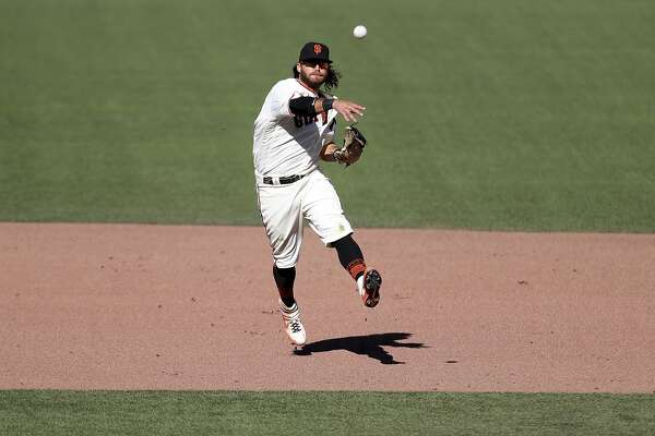 San Francisco Giants' Brandon Crawford throws against the Colorado Rockies during a baseball game in San Francisco, Thursday, Sept. 24, 2020. (AP Photo/Jed Jacobsohn)