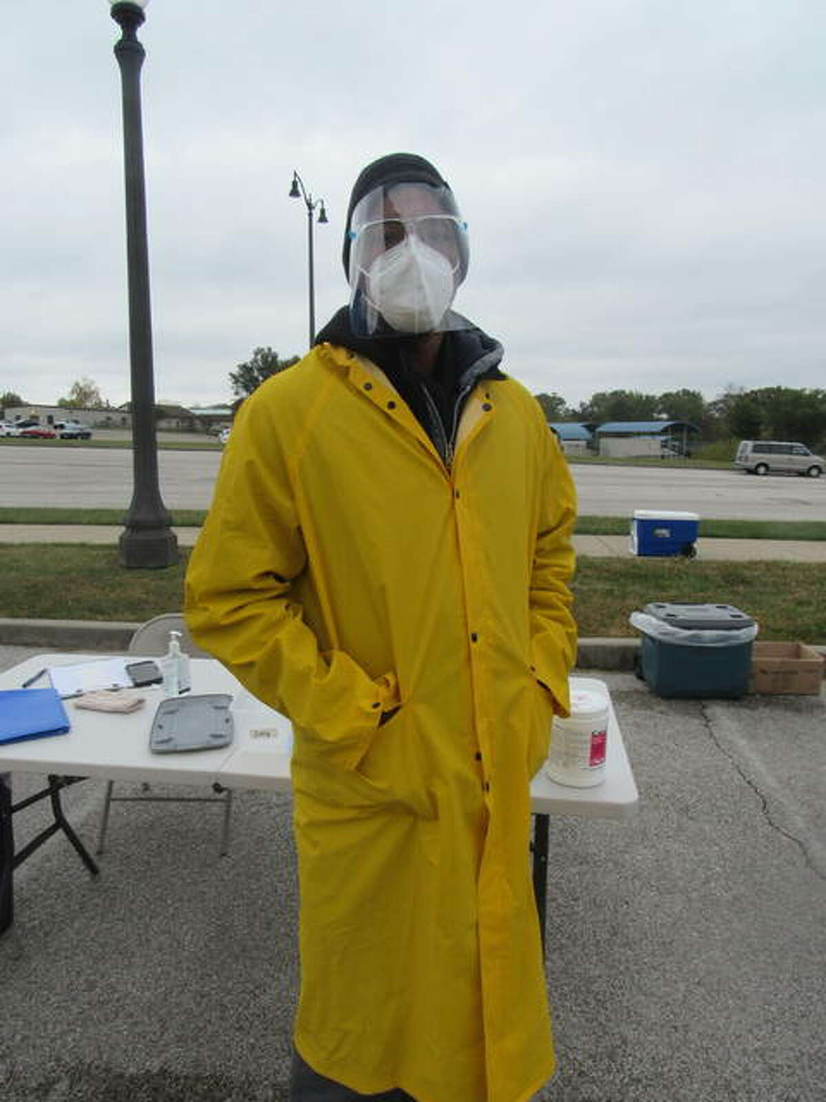 Jermone Jones awaits participants at coronavirus testing Tuesday at Lewis and Clark Community College in Godfrey.