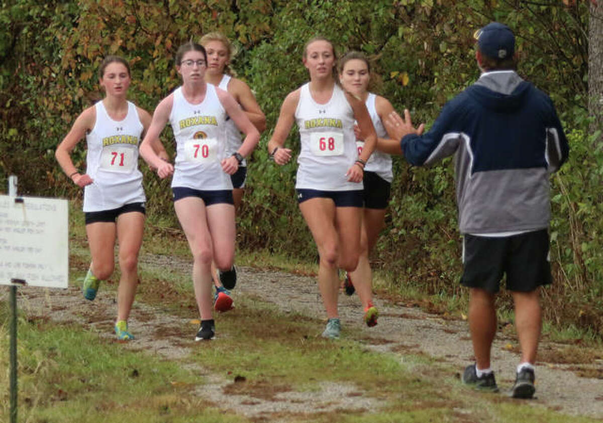 Roxana coach Scott Edwards asks his SCC Meet front-running pack of (from left) Gabrielle Woodruff, Riley Doyle, Zoey Losch, Janelynn Wirth and Keiko Palen slow their pace toward the end of the second mile of their 1-2-3-4-5 finish Monday at Southwestern High School in Piasa.