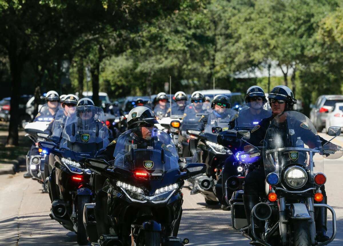 Houston Police motorcycle officers escort the body of Sgt. Harold Preston to the medical examiner's office from Memorial Hermann Hospital on Tuesday, Oct. 20, 2020, in Houston. Two officers were shot by a suspect during a domestic violence call at an apartment complex near El Rio and Holly Hall streets.