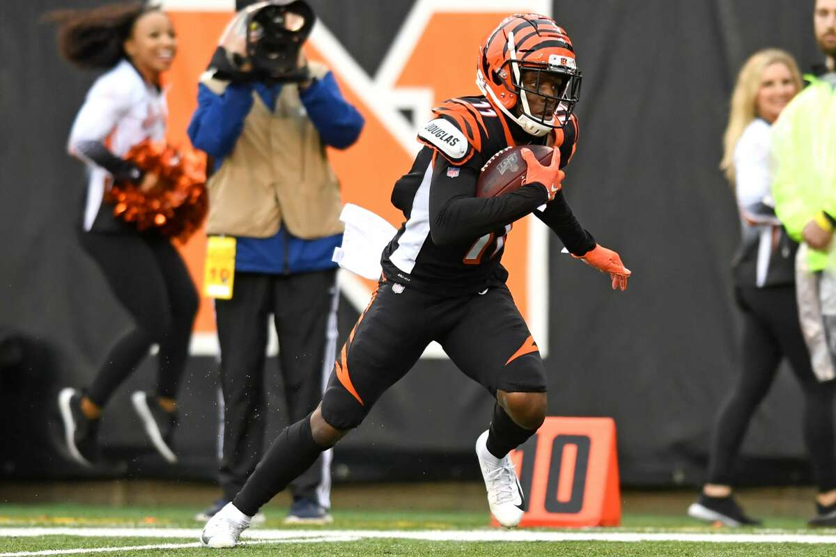 CINCINNATI, OH - DECEMBER 29, 2019: Wide receiver John Ross #11 of the Cincinnati Bengals carries the ball in the third quarter of a game against the Cleveland Browns on December 29, 2019 at Paul Brown Stadium in Cincinnati, Ohio. Cincinnati won 33-23. (Photo by: 2019 Nick Cammett/Diamond Images via Getty Images)
