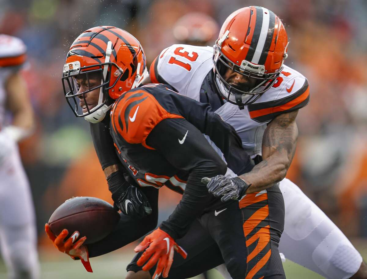 CINCINNATI, OH - DECEMBER 29: John Ross #11 of the Cincinnati Bengals is tackled by Juston Burris #31 of the Cleveland Browns during the second half at Paul Brown Stadium on December 29, 2019 in Cincinnati, Ohio. (Photo by Michael Hickey/Getty Images)