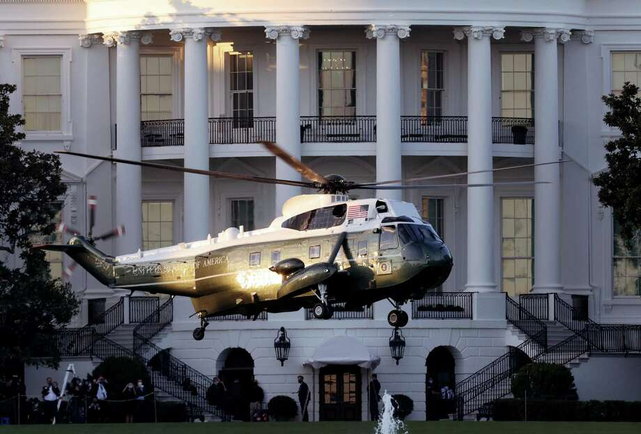 Marine One, the presidential helicopter, carries U.S. President Donald Trump away from the White House on the way to Walter Reed National Military Medical Center October 2, 2020 in Washington, DC.(Photo by Win McNamee/Getty Images) Photo: Win McNamee / Getty Images / 2020 Getty Images