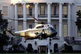 WASHINGTON, DC - OCTOBER 02: Marine One, the presidential helicopter, carries U.S. President Donald Trump away from the White House on the way to Walter Reed National Military Medical Center October 2, 2020 in Washington, DC. Trump announced earlier today via Twitter that he and U.S. first lady Melania Trump have tested positive for coronavirus. (Photo by Win McNamee/Getty Images)