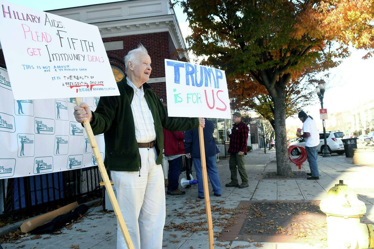 Trump supporter Wilm Donath joins a group supporting Republican presidential candidate Donald Trump rallies in downtown Stamford, Conn., Nov. 4, 2016.