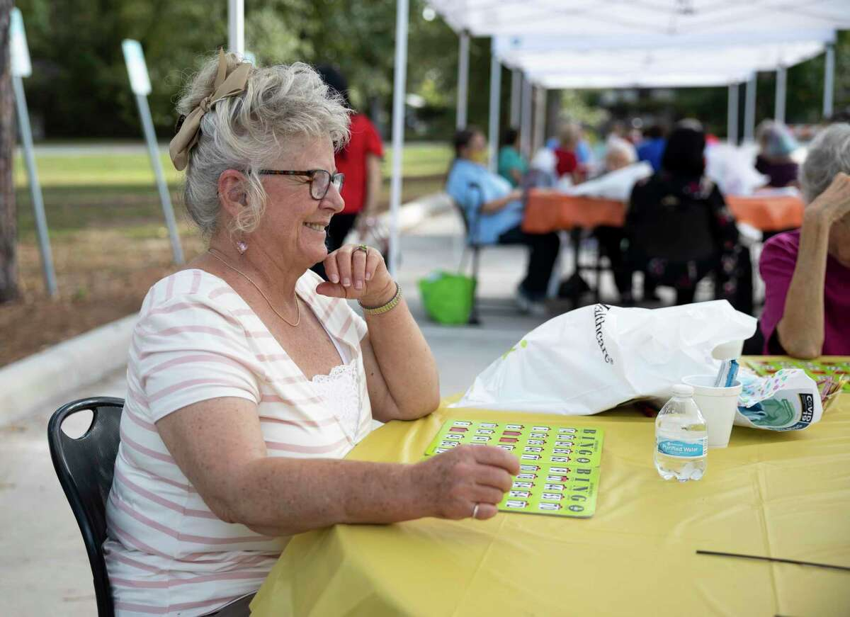Darlene plays a round of bingo during an event hosted by the Conroe Senior Center called the Parking Lot Party at Candy Cane Park, Tuesday, Oct. 20, 2020, in Conroe. Participants were able to play bingo, receive prizes and enjoy a complimentary lunch from Red Brick Tavern.